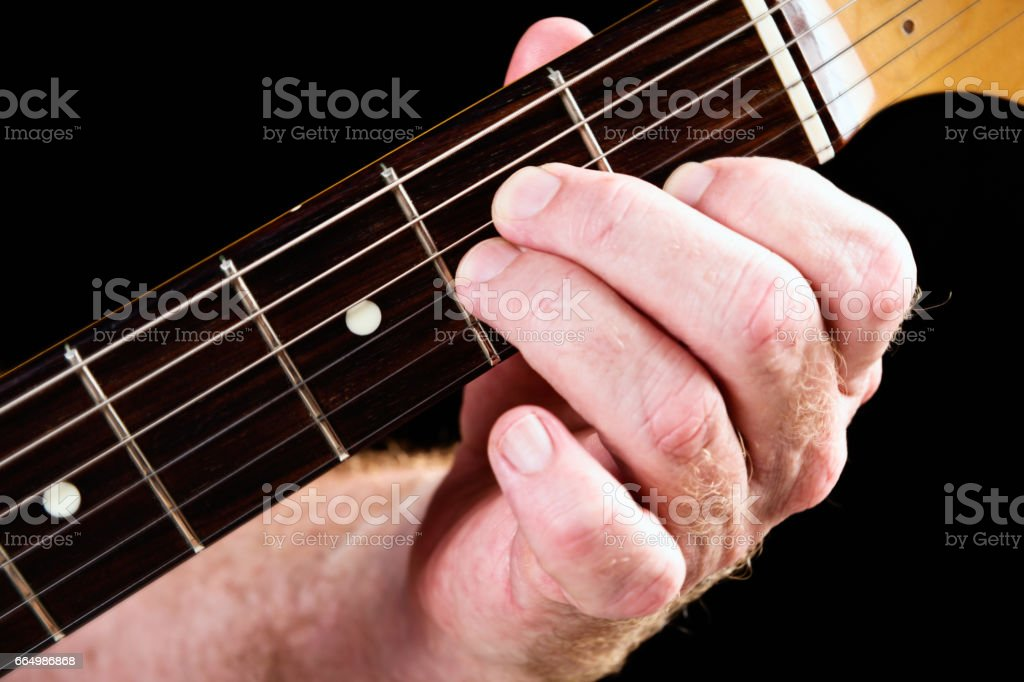 Guitar tutorial: the A minor chord demonstration on electric guitar stock photo