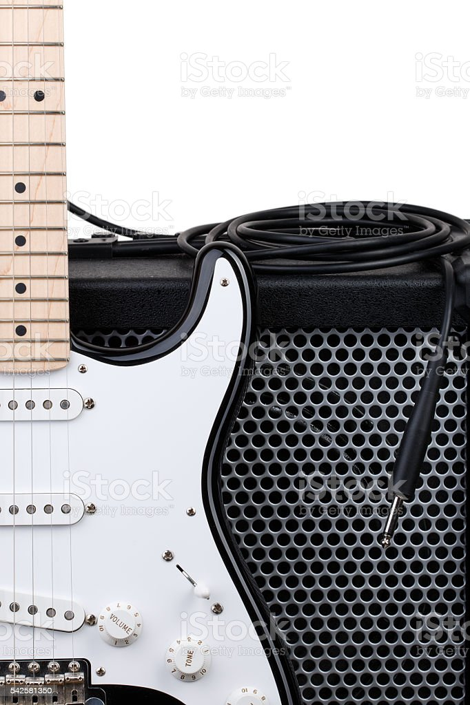 Guitar with amplifier and audio cord stock photo