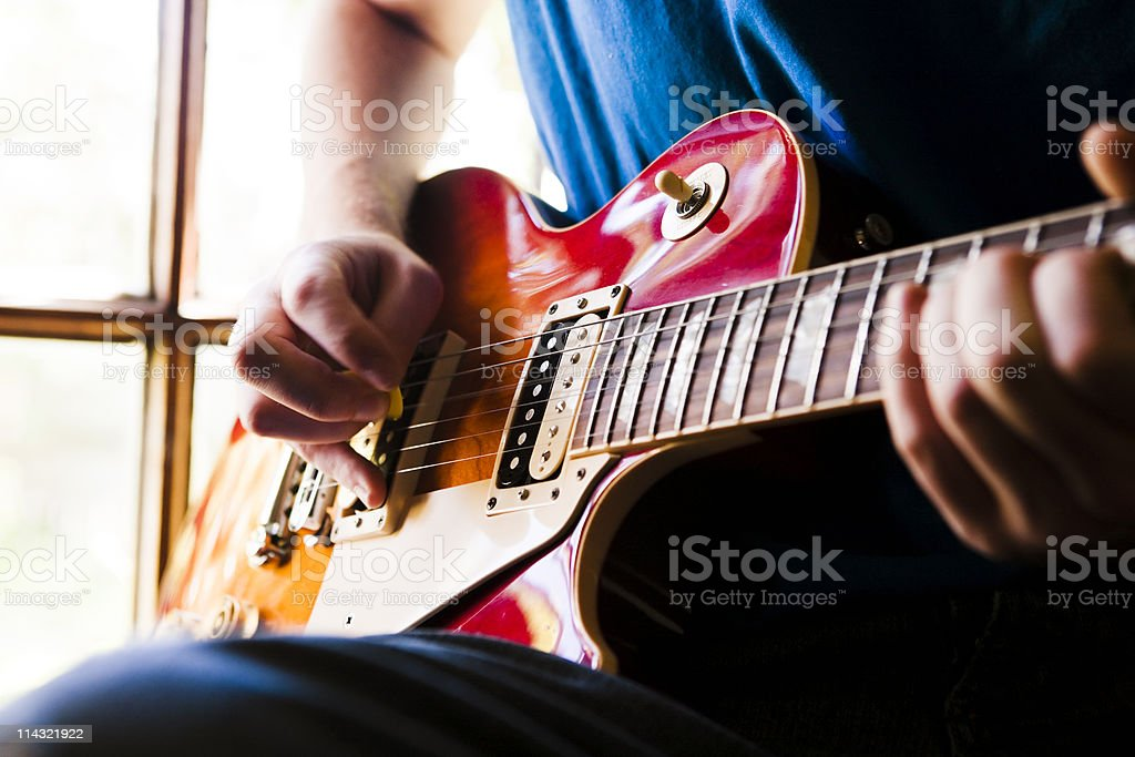 Guitarist against window royalty-free stock photo