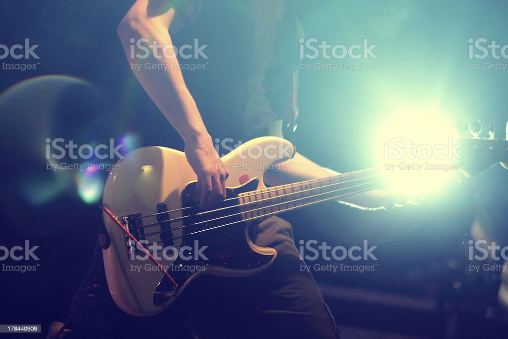 Guitarist at nightclub, blur in moving stock photo