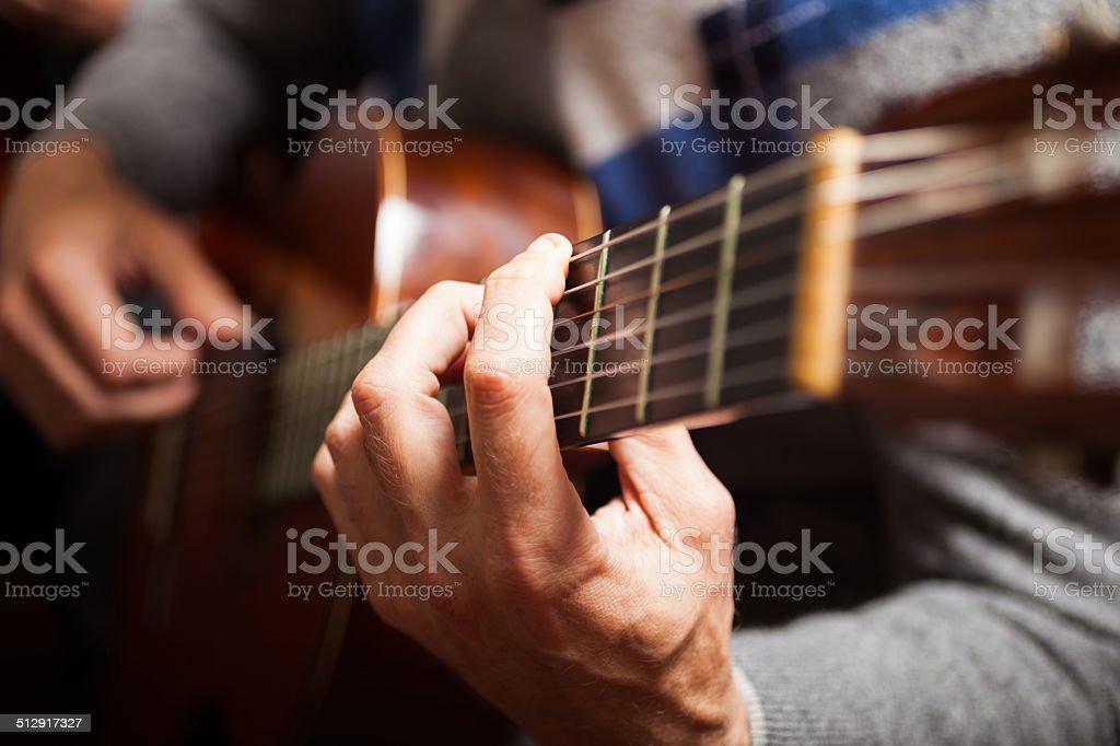Guitarist hands stock photo
