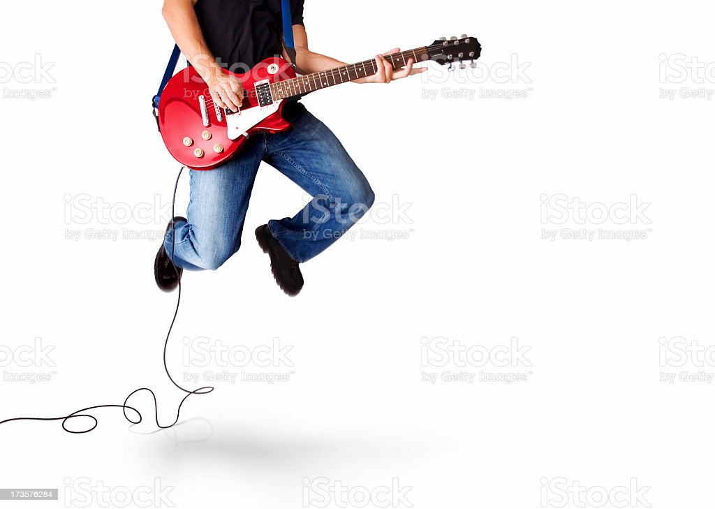Guitarist jumping high in the air stock photo