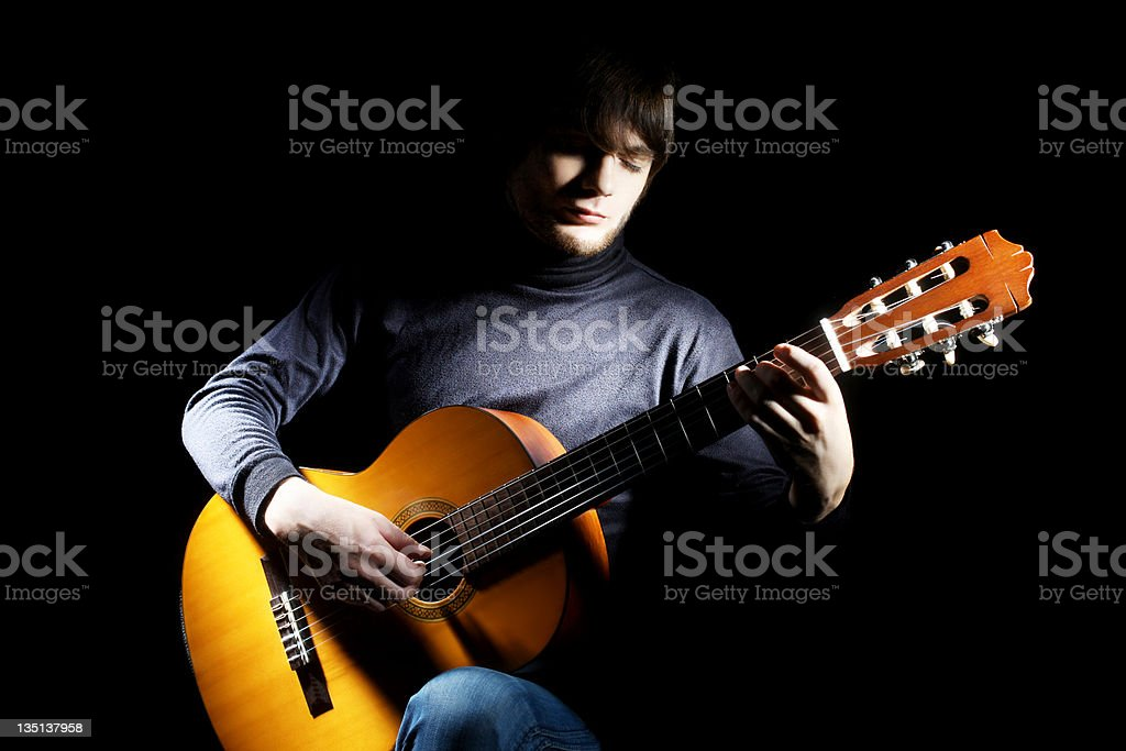 Guitarist musician guitar acoustic playing. stock photo