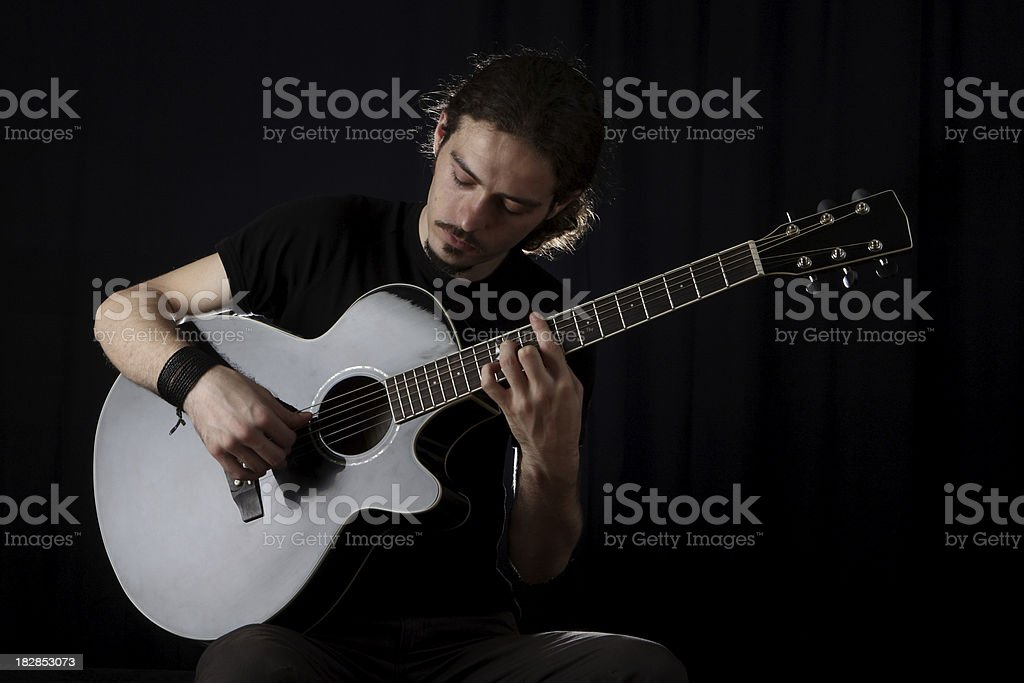 guitarist on black background royalty-free stock photo