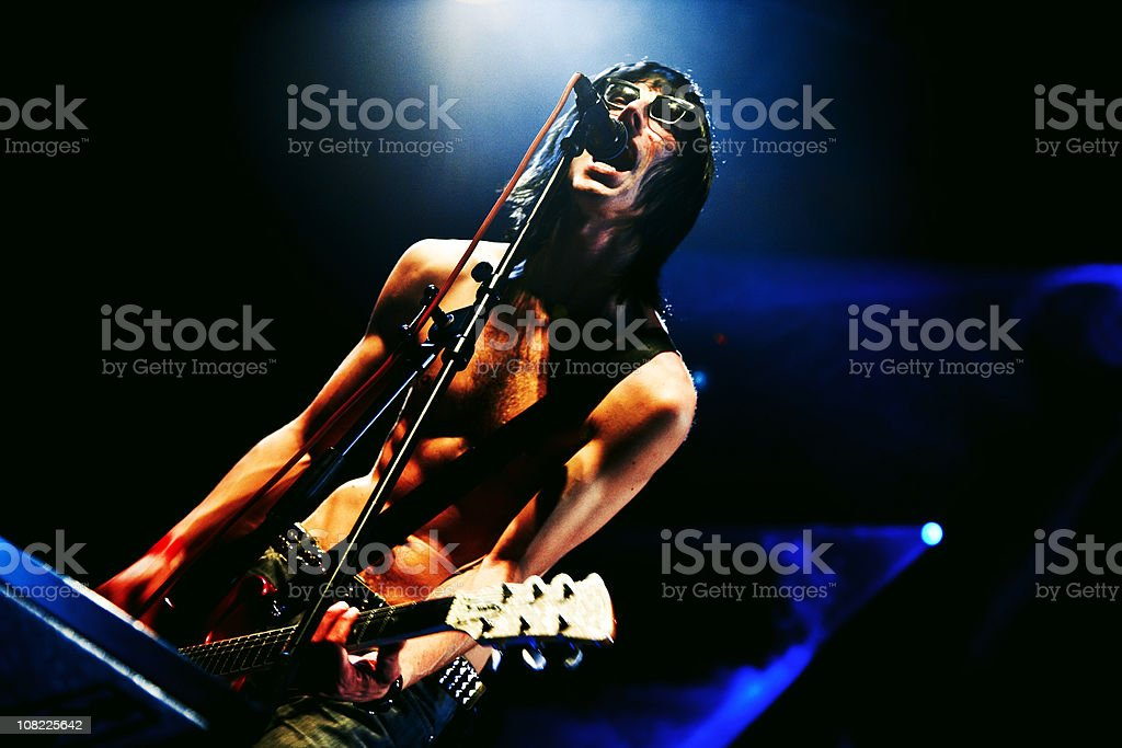 Guitarist on Stage at Rock Concert, Low Key royalty-free stock photo