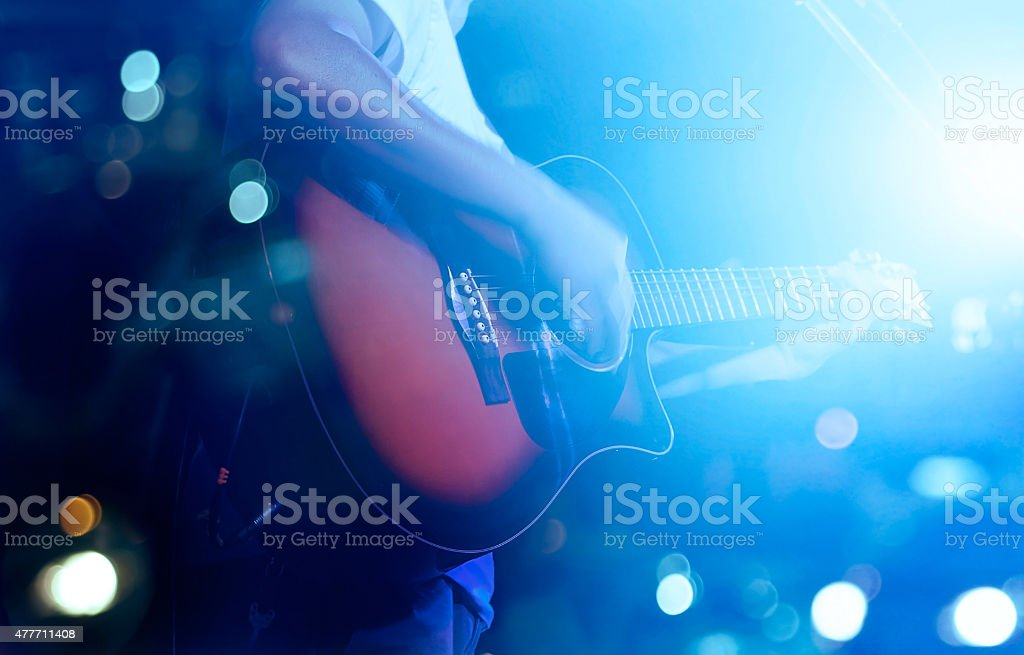 Guitarist on stage grunge background, soft and blur concept stock photo