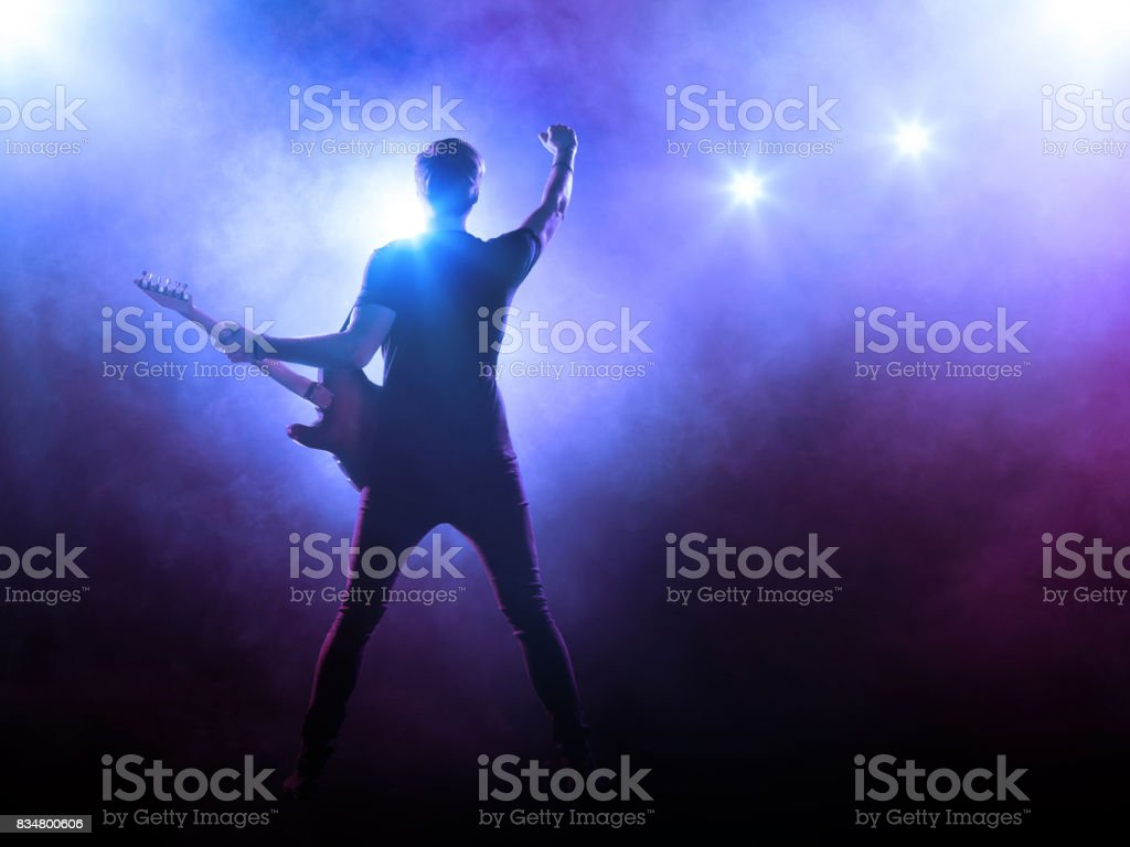 Guitarist performing on stage stock photo