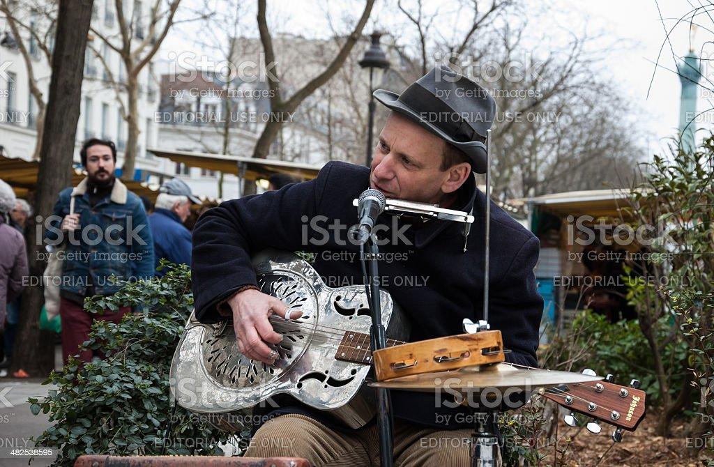 Guitarist playing guitar at street market in Paris, France. stock photo