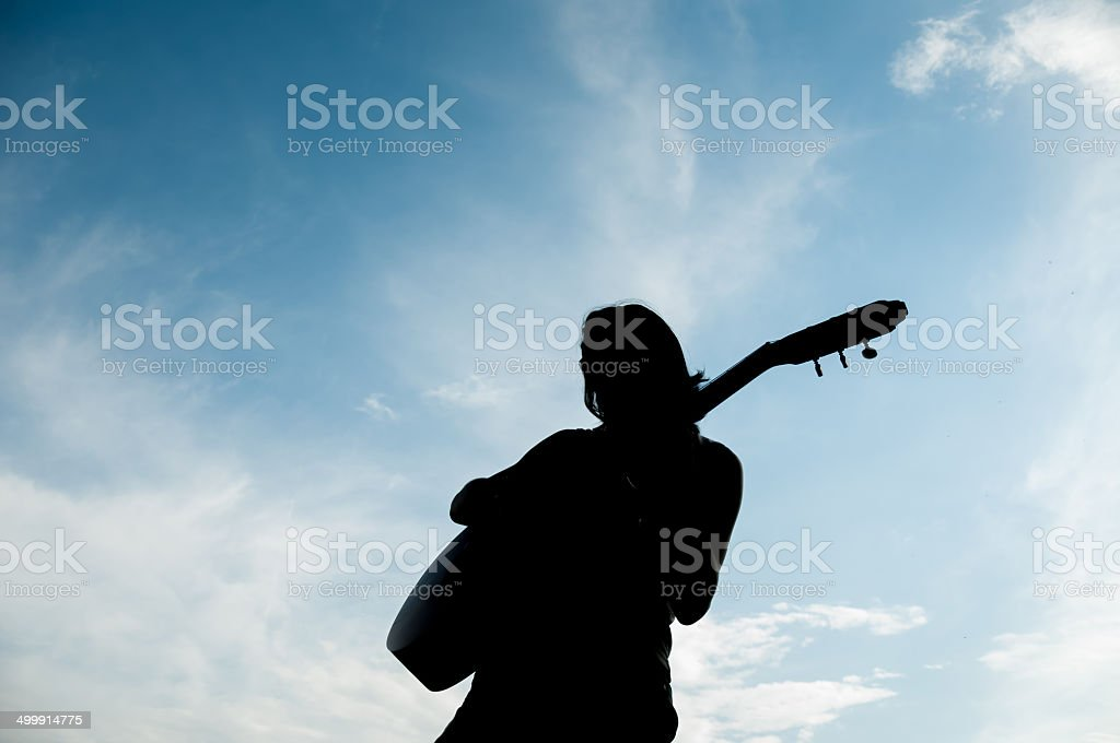 guitarist playing outdoor stock photo