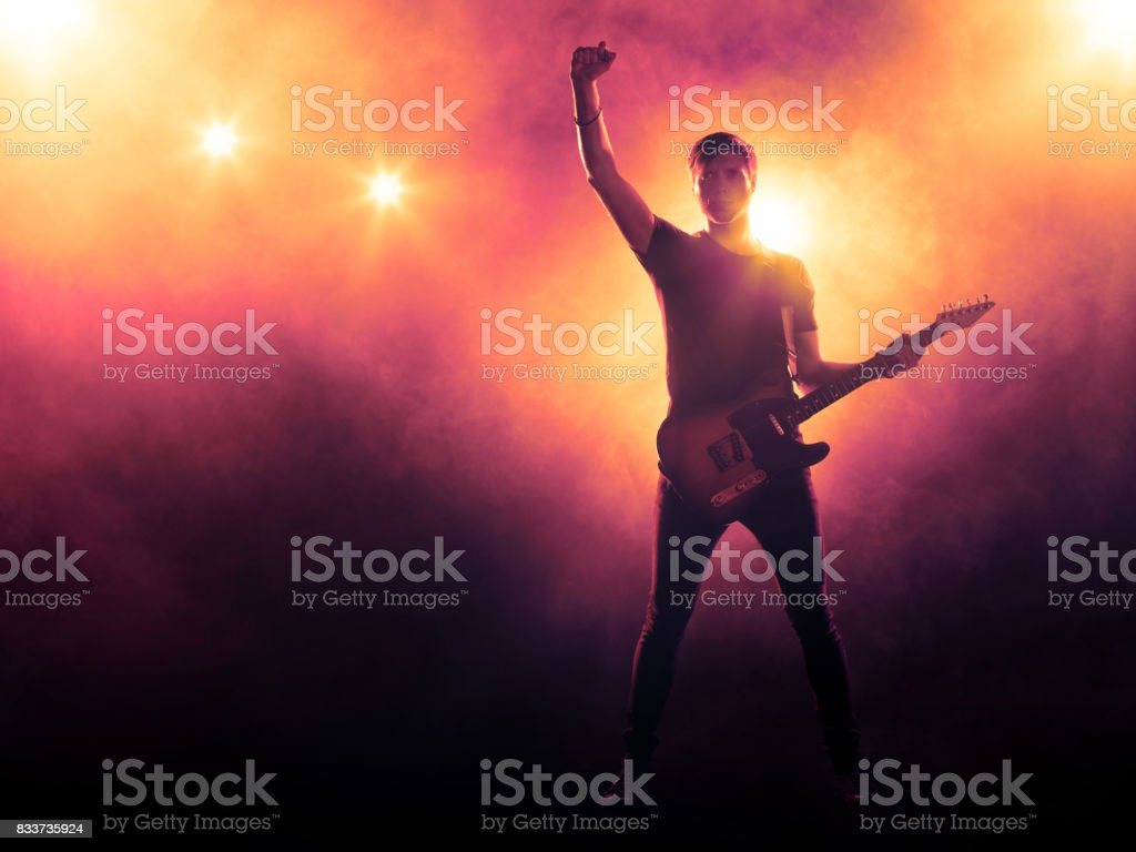 Guitarist playing solo on stage stock photo