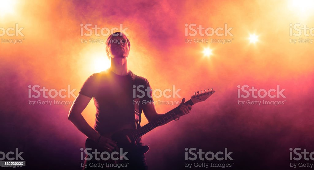 Guitarist playing solo stock photo