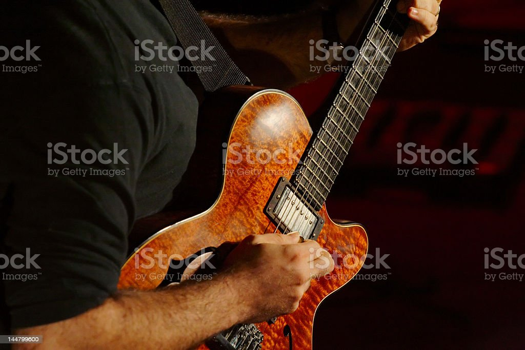 Guitarist playing the guitar at concert stock photo