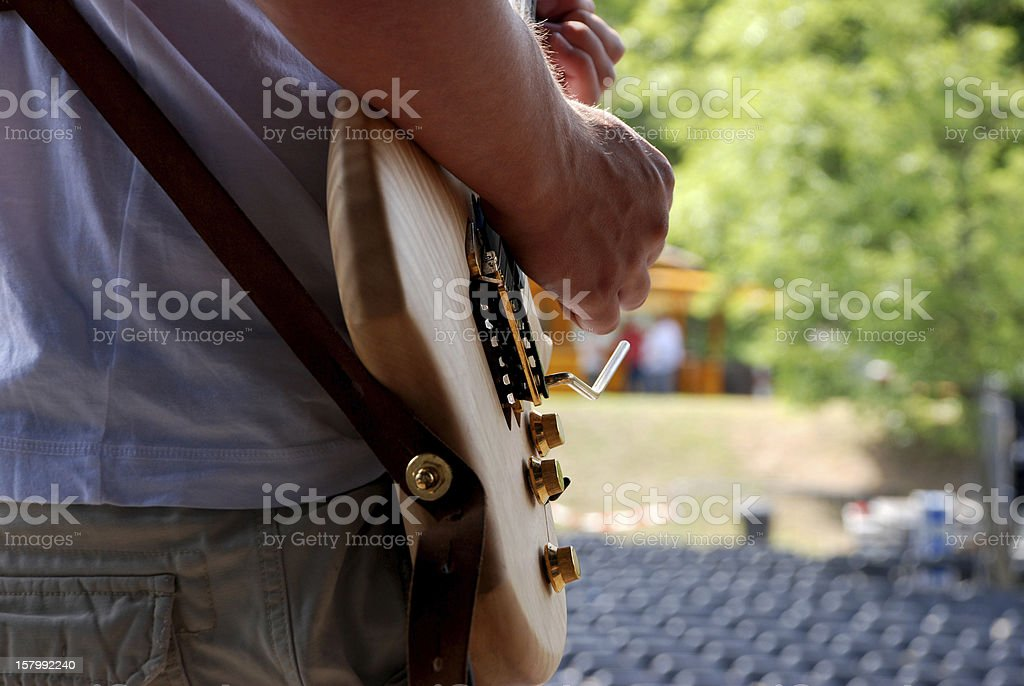 Guitarist plays during a soundcheck on stage stock photo