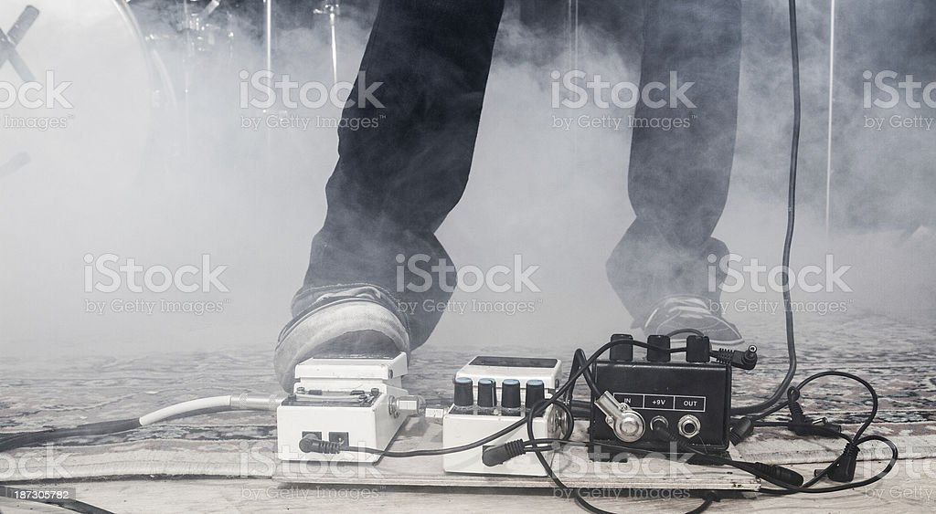 Guitarist using a footpedal stock photo