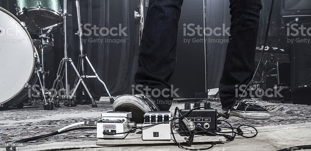Guitarist using a footpedal royalty-free stock photo