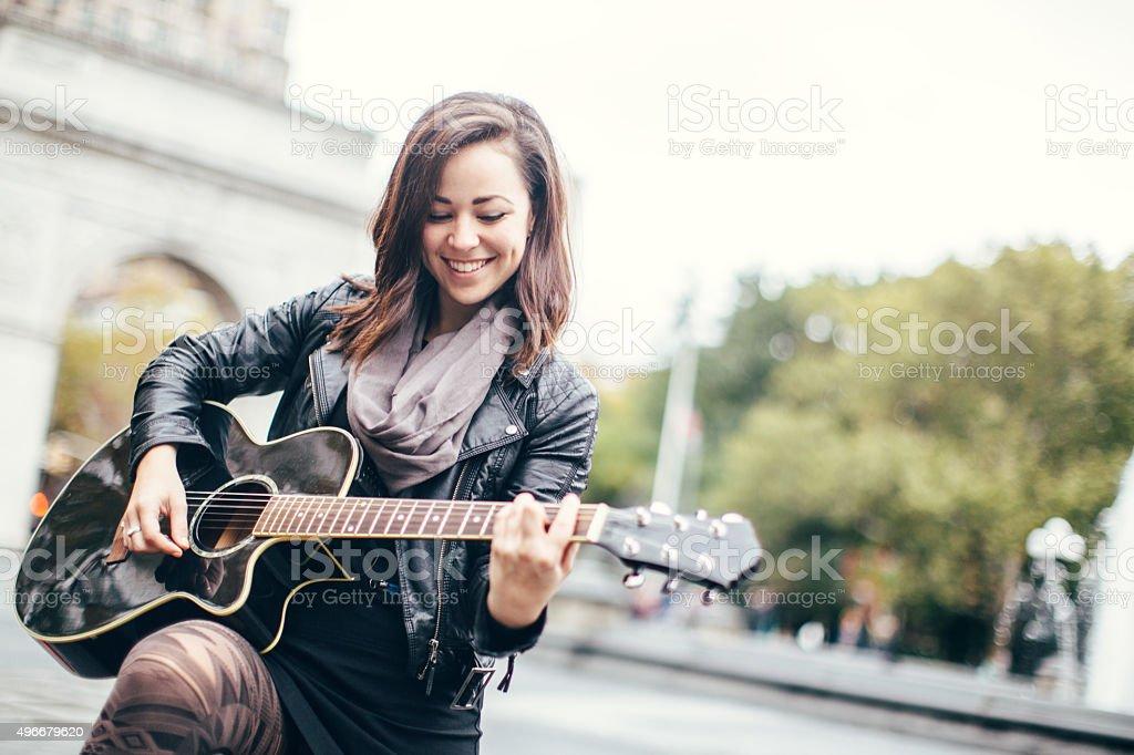 Guitarist Woman in Washington Square Park stock photo