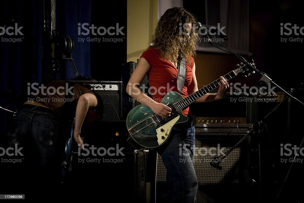 guitarist, young women in a rock band stock photo