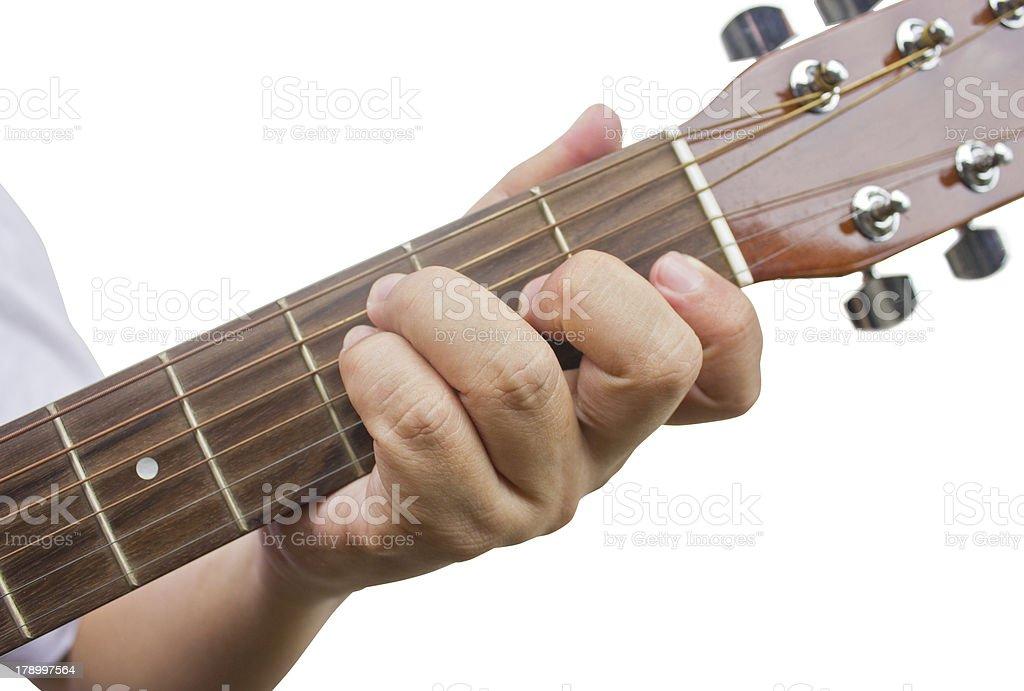 Guitarist's hand show F chord. stock photo