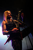guitarrist and vocalist of metal band at club Concert