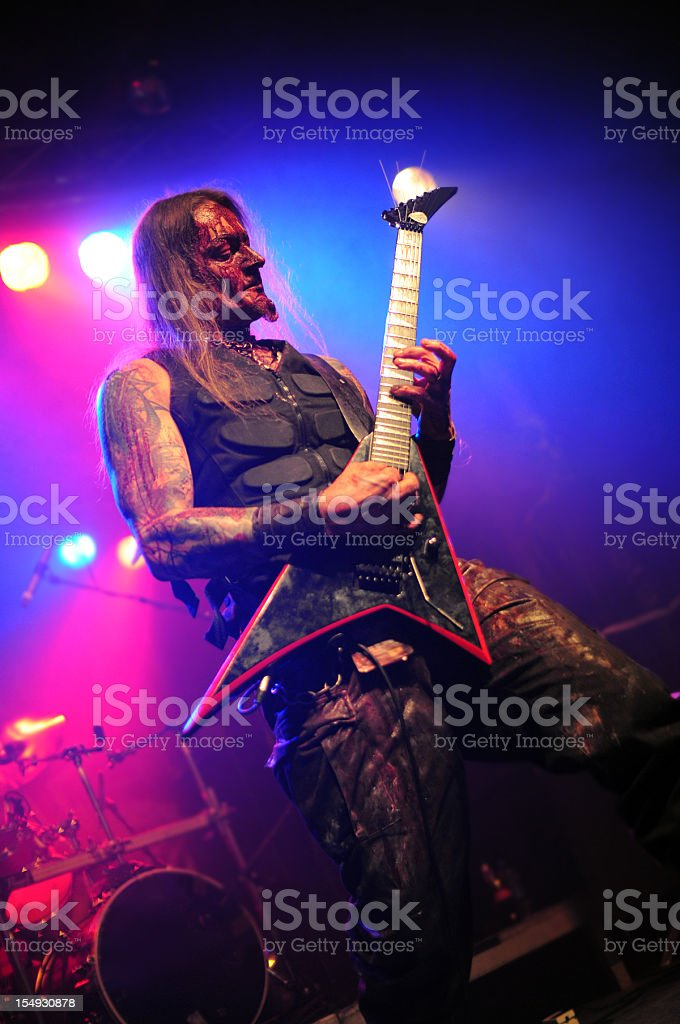 guitarrist and vocalist of metal band at club Concert stock photo