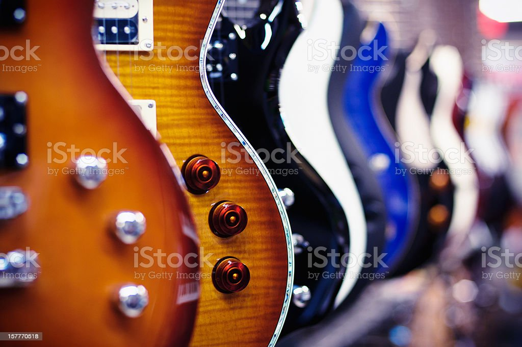Guitars in a shop stock photo