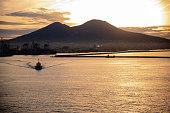 Gulf of Naples, a a tug boat, Mount Vesuvius at sunrise