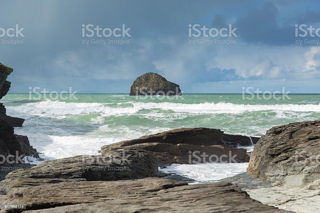 Gull Rock white waves breaking Trebarwith Strand Cornwall England UK stock photo