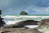 Gull Rock white waves breaking Trebarwith Strand Cornwall England UK