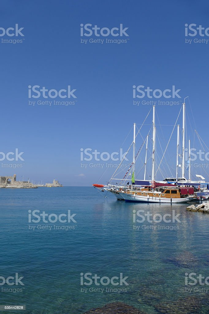 Gullets moored in Rhodes harbour, Greece stock photo