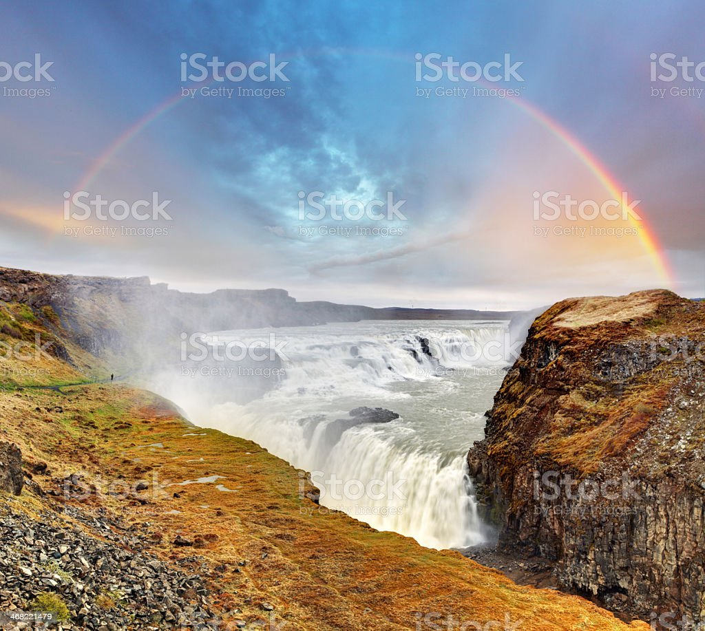 Gullfoss waterfall , Iceland on a sunny day with a rainbow stock photo