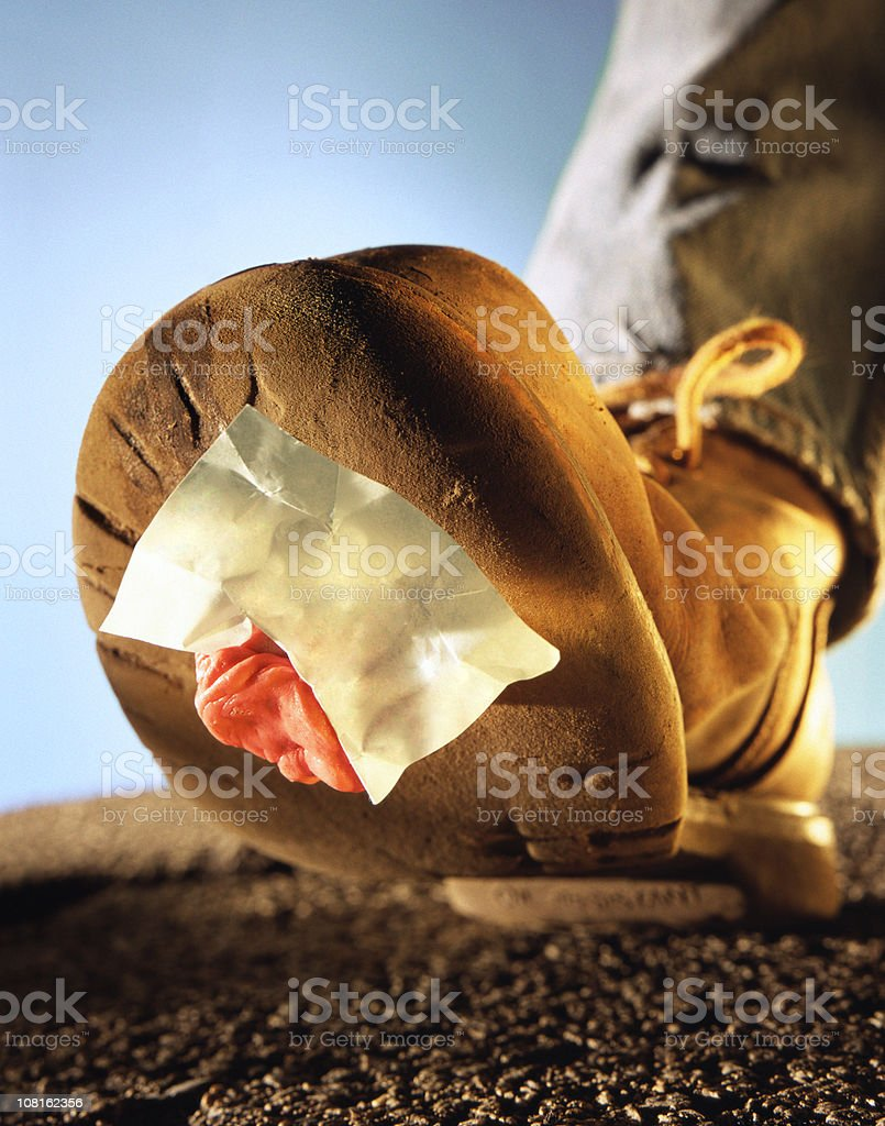 Gum and Paper Stuck to Bottom of Work Boot stock photo