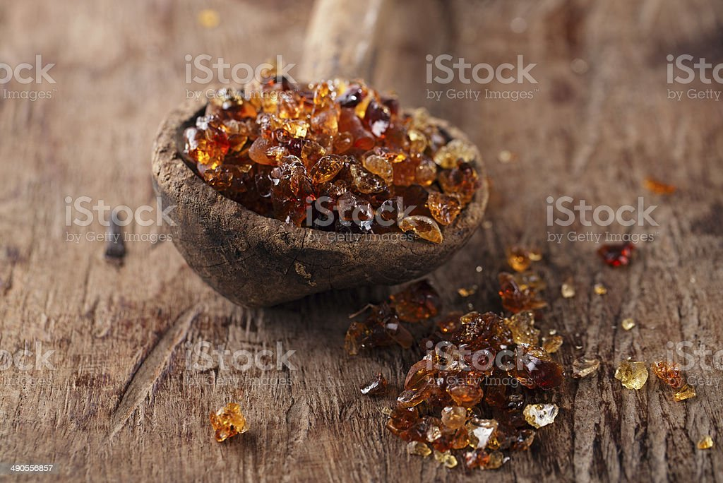 Gum arabic, also known as acacia in  old wooden spoon stock photo