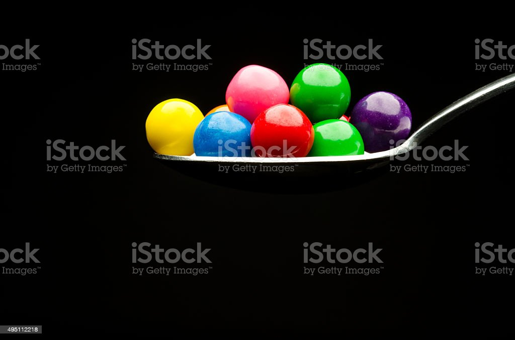 Gumballs on a spoon stock photo