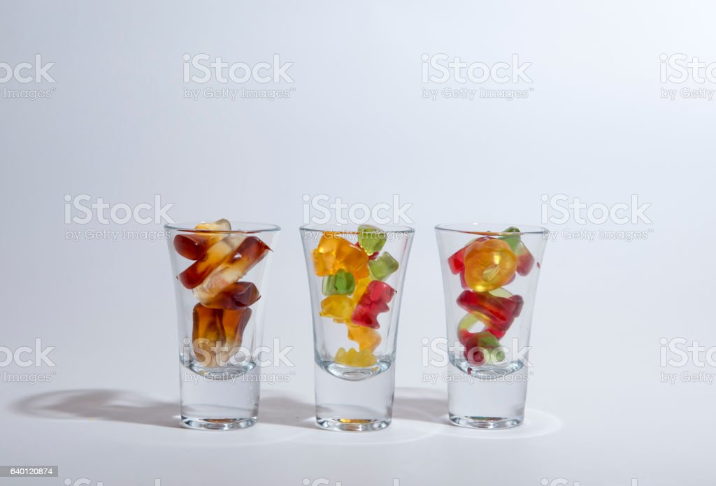 Gummy sweets in glasses. stock photo