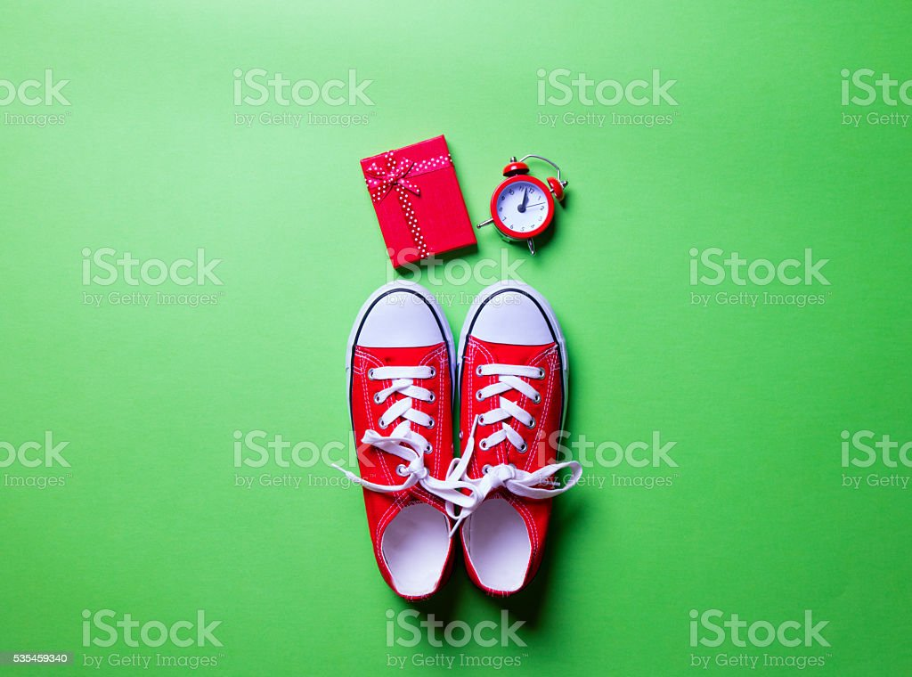 gumshoes, clock and gift stock photo