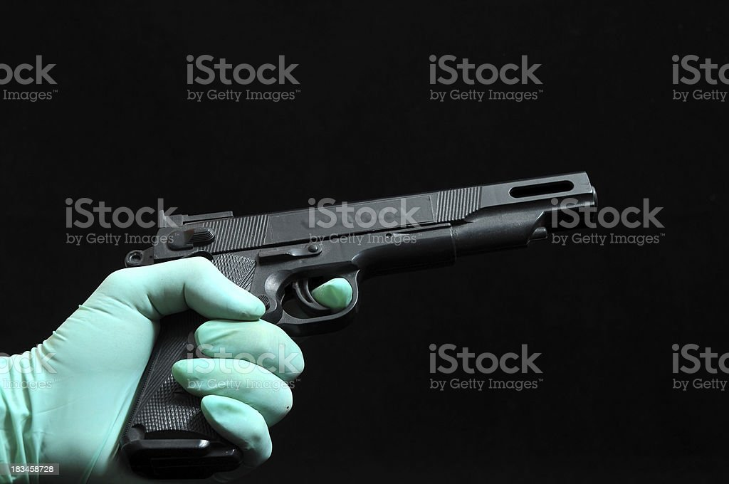 Gun and a Hand royalty-free stock photo