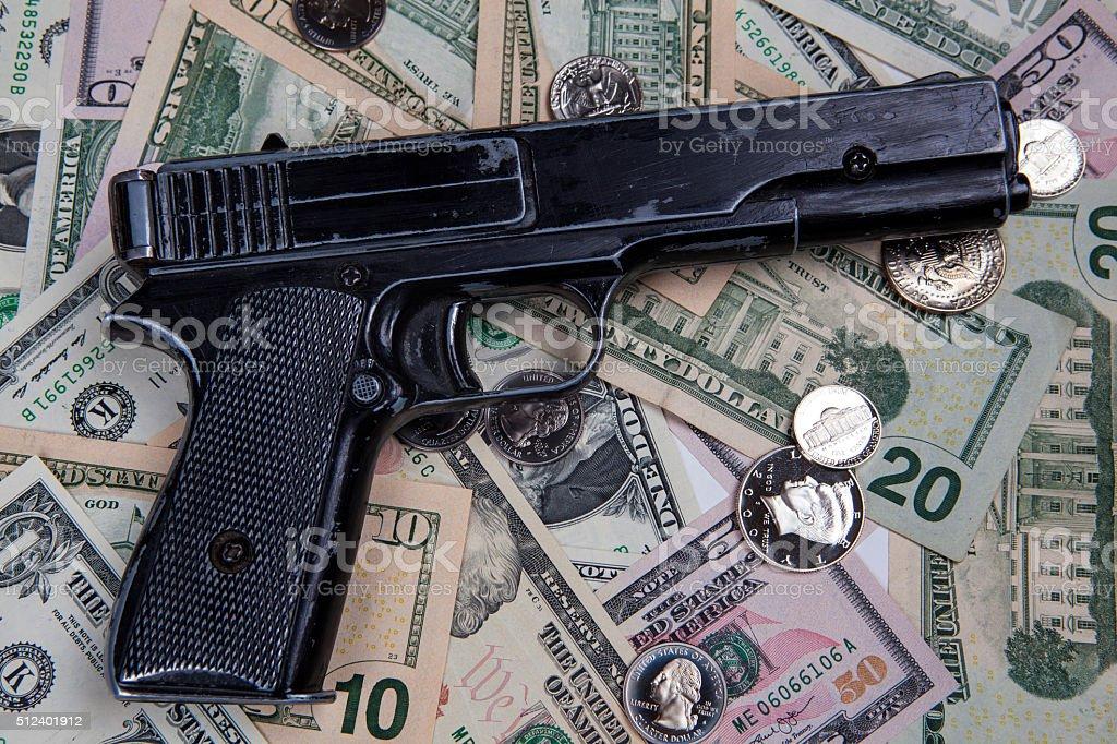Gun and bankroll stock photo