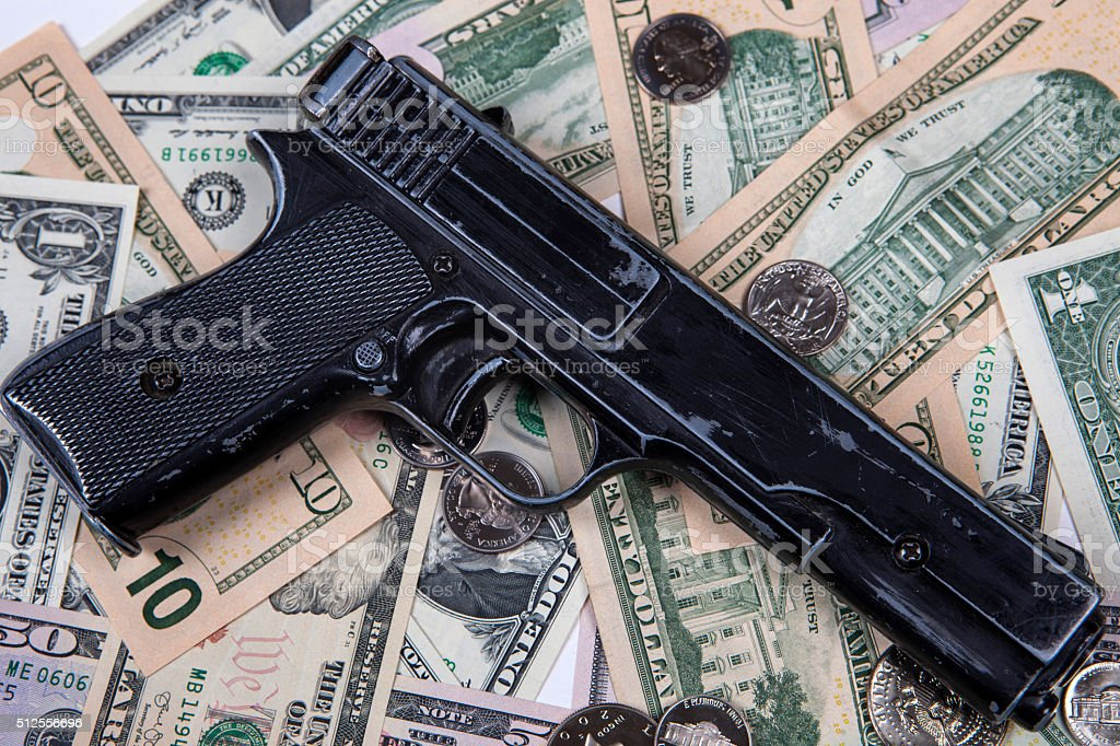 Gun and bankroll stock photo