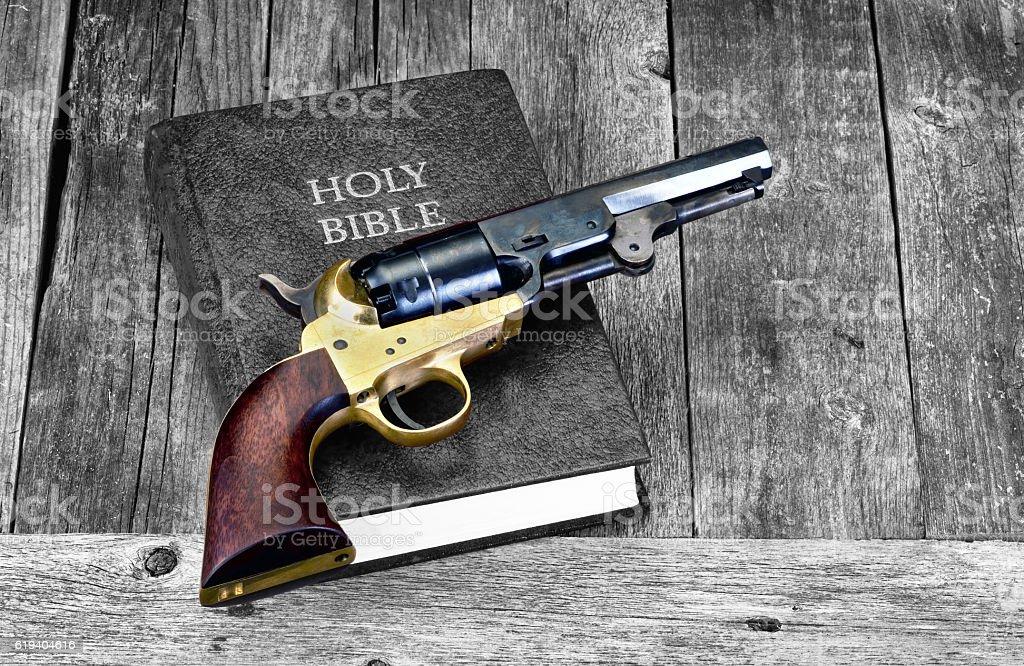 Gun and Bible. stock photo