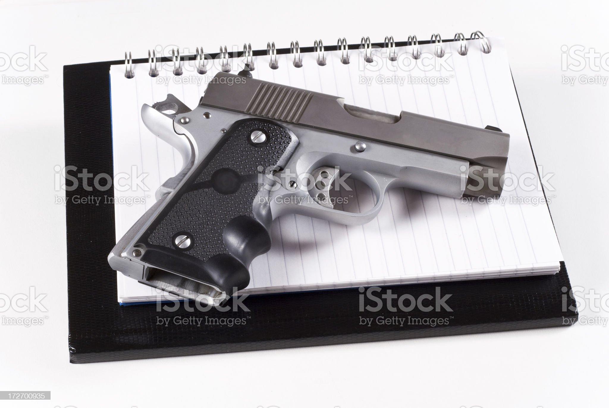 Gun and books royalty-free stock photo