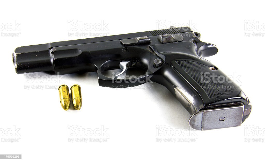 Gun and bullets isolated on white background royalty-free stock photo