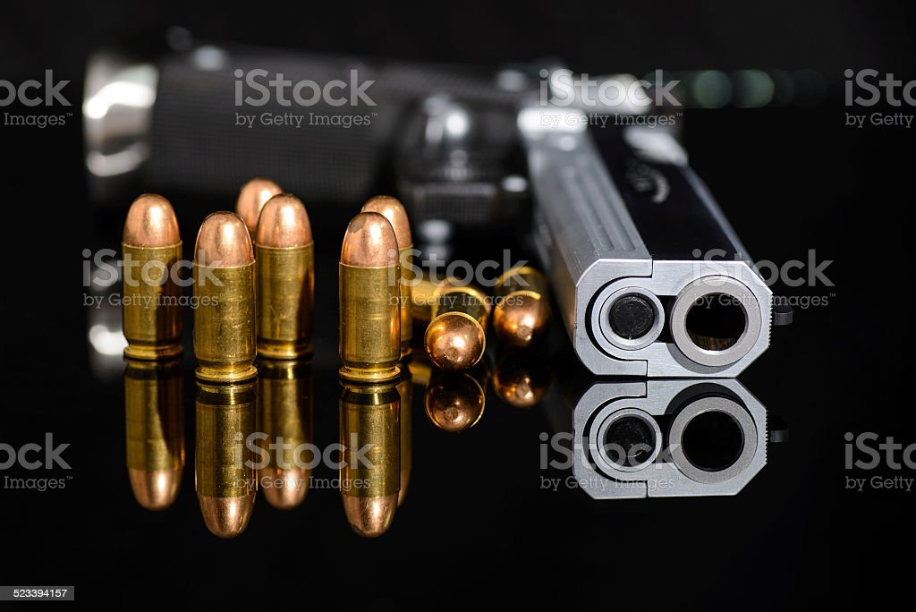 Gun and bullets stock photo