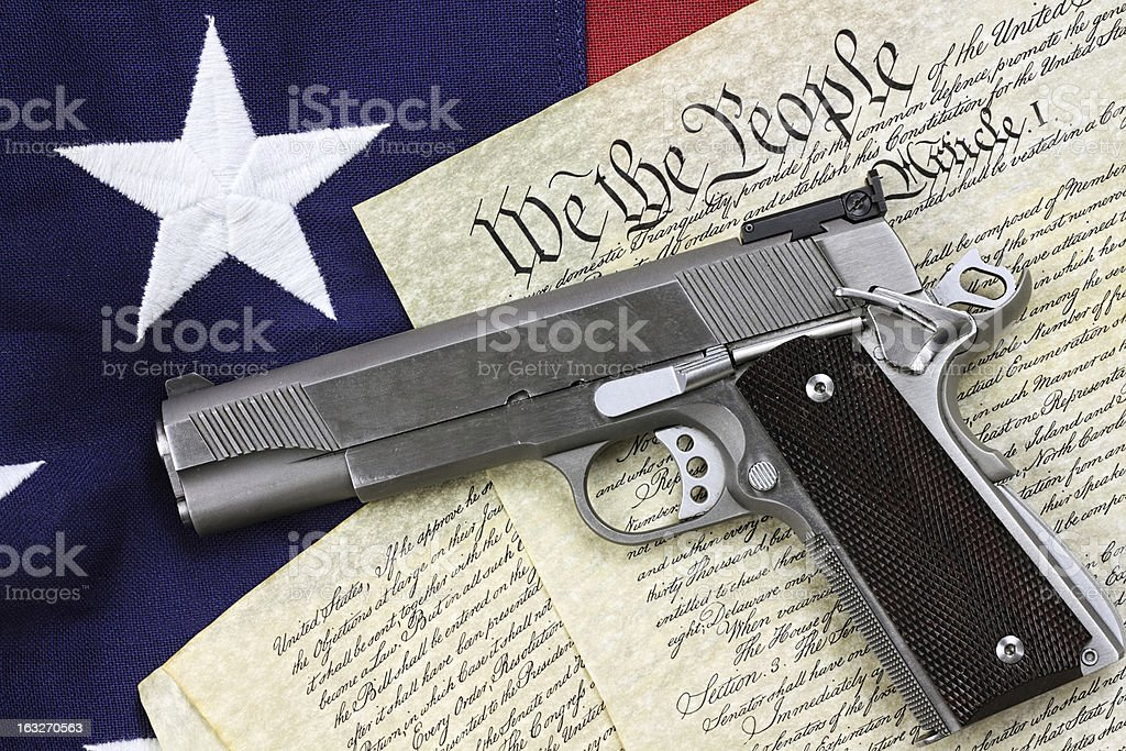 Gun and Constitution stock photo