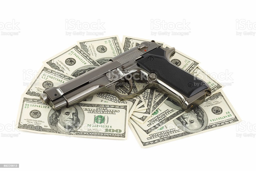 Gun and money stock photo
