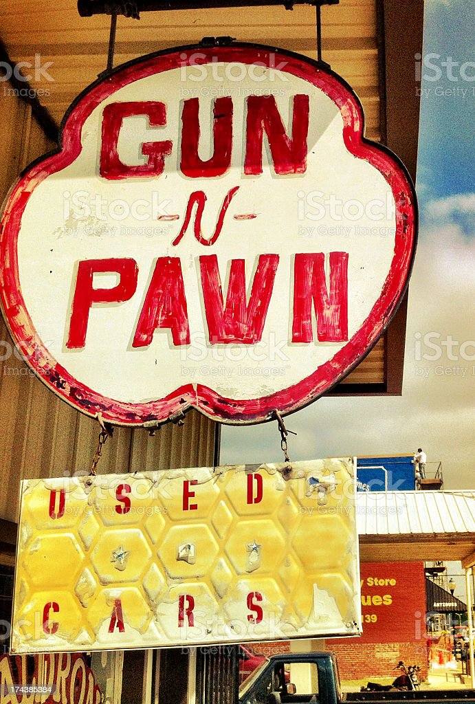 Gun and Pawn store sign in USA royalty-free stock photo
