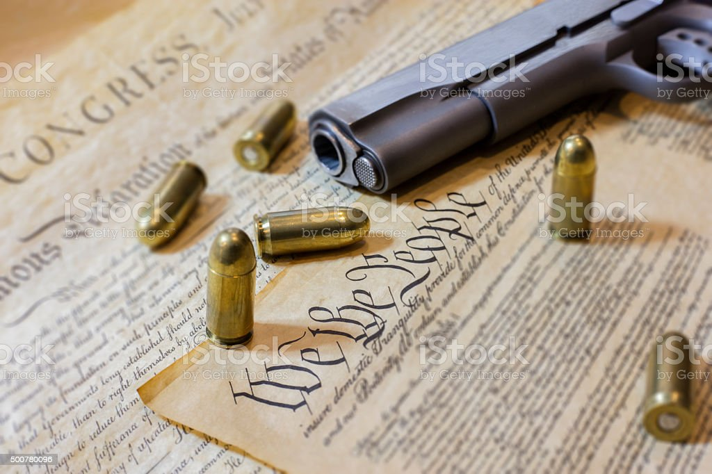 Gun and the US Constitution stock photo