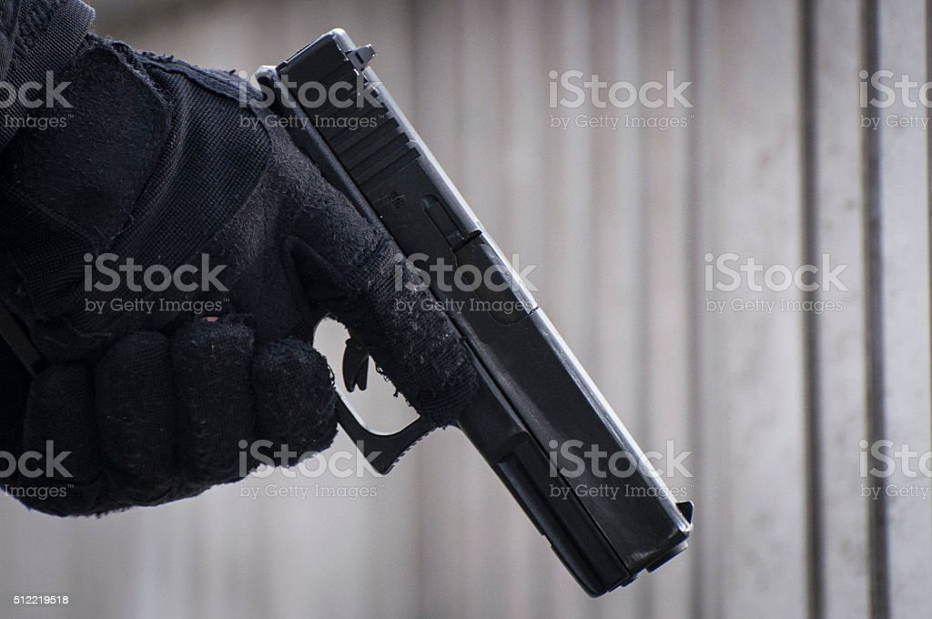 Gun Being Held stock photo
