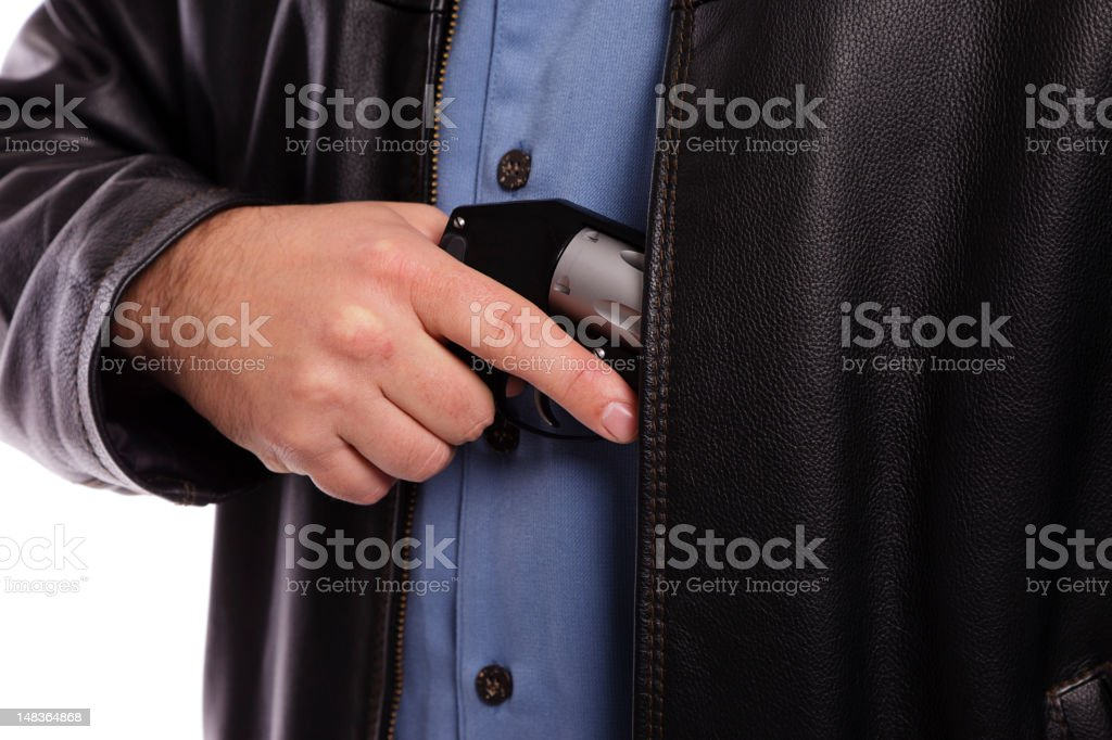 Gun Being Pulled From Jacket royalty-free stock photo