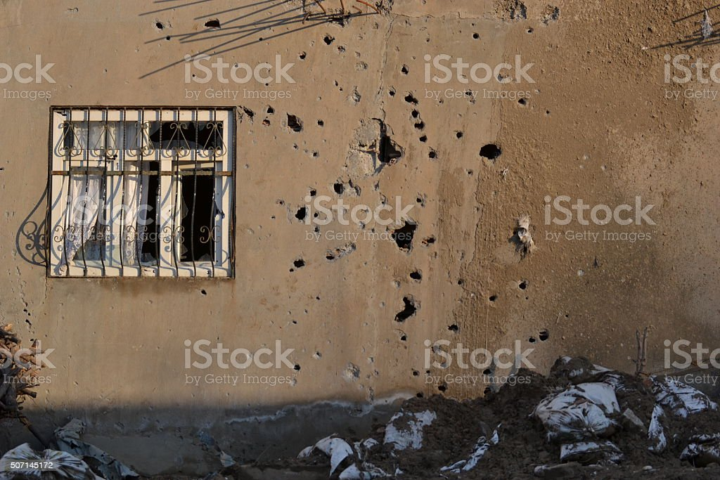 Gun bullet-riddle room and window stock photo