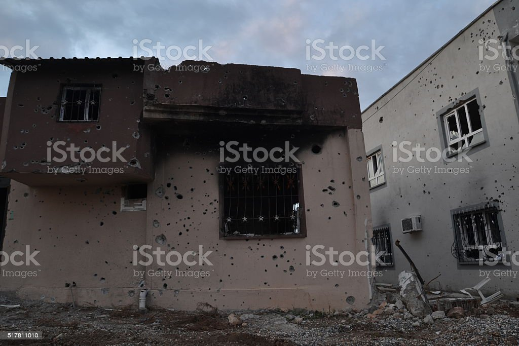 Gun bullet-riddle und burned with bomb buildings stock photo